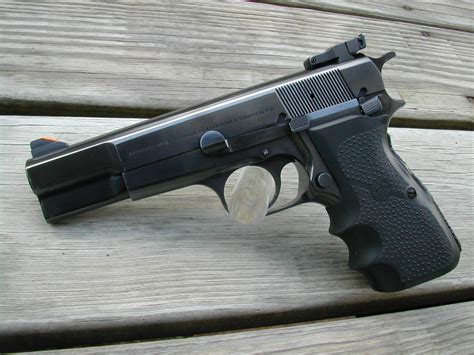 A Browning Hi Power is acquired