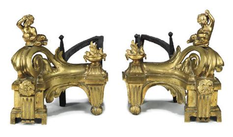 A PAIR OF FRENCH ORMOLU AND CAST-IRON CHENETS , POSSIBLY